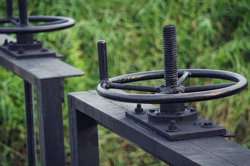 Close-up of machine valve outdoors