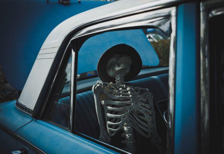 Skeleton in vintage car