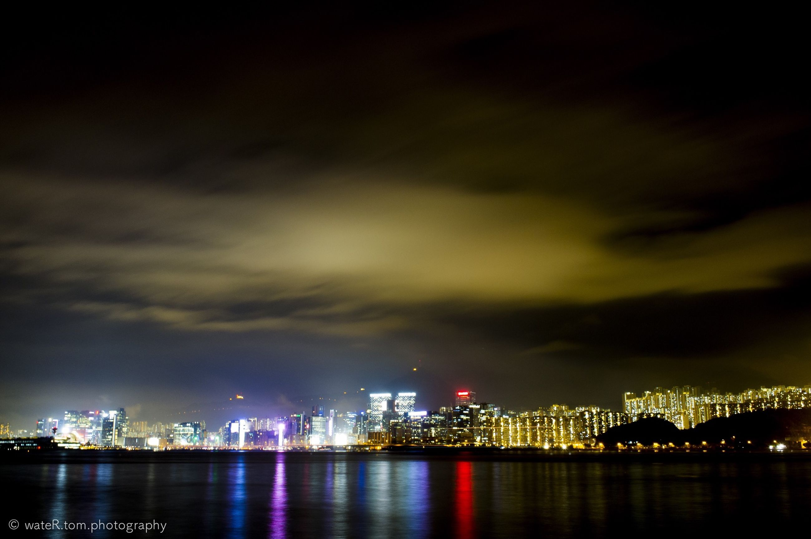 illuminated, night, water, waterfront, city, architecture, built structure, building exterior, sky, river, cityscape, reflection, urban skyline, cloud - sky, sea, skyscraper, dusk, outdoors, no people, bridge - man made structure