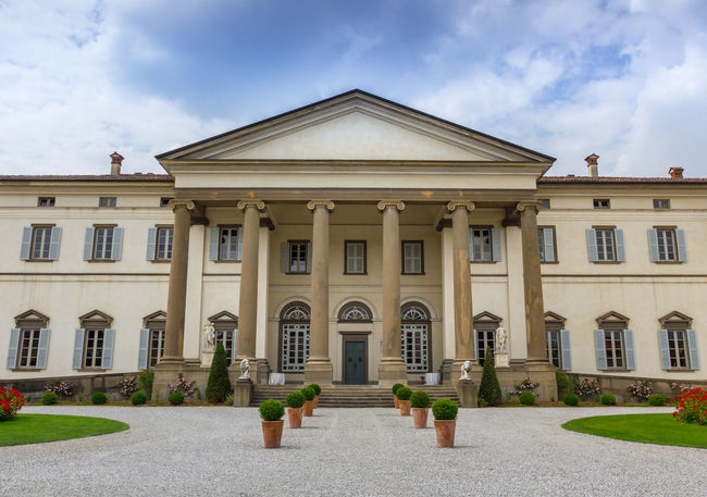 Feature Italian villa used for ceremonies and weddings Ancient Architecture Blue Building Cloudy Coloumns Culture Europe Flowerpots Garden Gate Green House Italy Luxury Outdoors Perspective Scene Sky Stairs Triangle Venetian Villa Wedding Windows