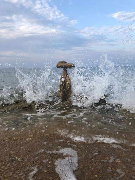 Stone balancing Stone Balancing Water Motion Sea Splashing Wave Nature Sky Real People Day Beauty In Nature Beach Land One Person Horizon Over Water Horizon Scenics - Nature Aquatic Sport Outdoors Power In Nature Cloud - Sky