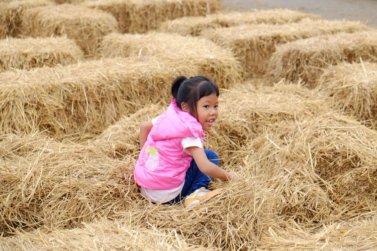 Girl sitting on hay