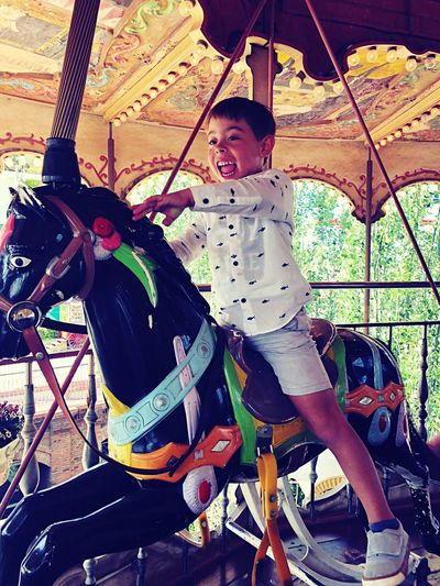 Zara Kids EyeEmNewHere IPhoneography Child Childhood Real People Leisure Activity One Person Full Length Day Amusement Park Boys Enjoyment Amusement Park Ride Carousel