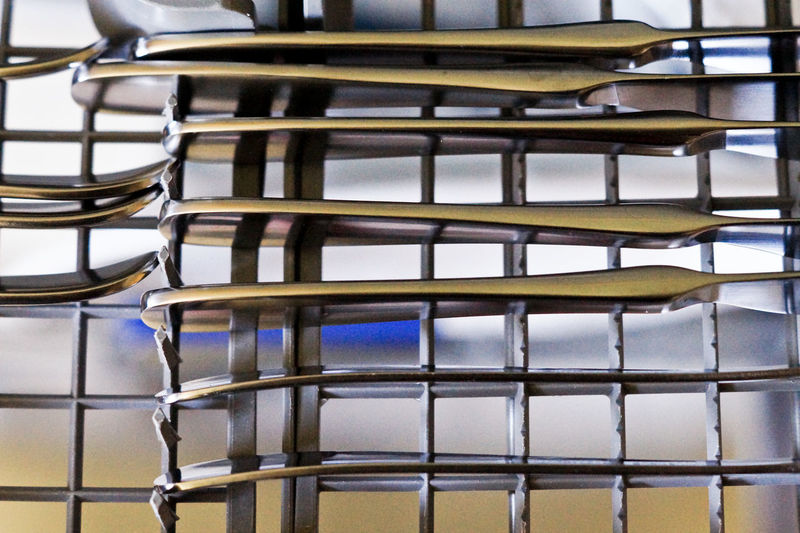 Close-up of eating utensils in dishwasher