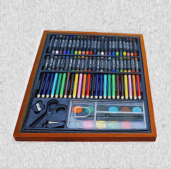 High angle view of multi colored pencils on table against wall