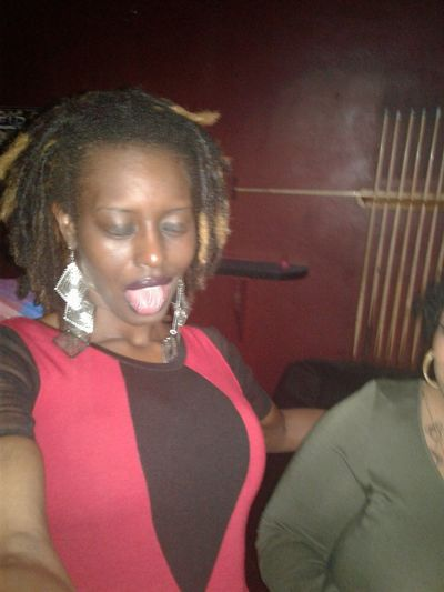 Confidence  One Woman Only Cheerful Lesbian Love  Close-up Waist Up Chocolate Kisses Facial Expression Lips Melanin Sensual 💕 Beauty Redefined Smiling Oculus Dreadlocs Beauty Drunk Nights Lifestyles Enjoyment 😚 Lesbian Beautiful Skin Nightlife Adult