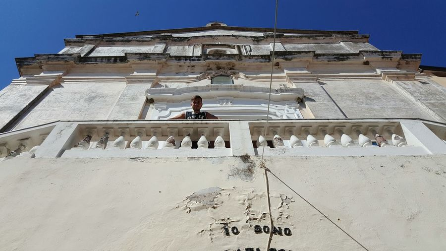 Low angle view of man standing at historical building
