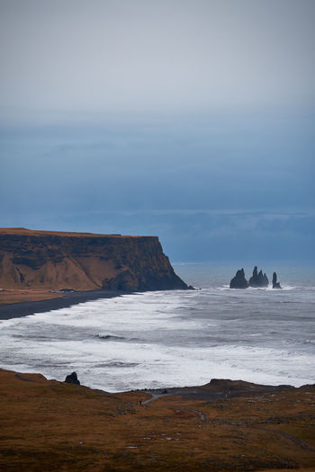 Sea Water Land Scenics - Nature Rock Beauty In Nature Tranquil Scene Beach Rock - Object Tranquility Nature Solid Rock Formation No People Idyllic Non-urban Scene Horizon Cloud - Sky Horizon Over Water Outdoors Stack Rock Iceland Coastline Reynisfjara Vertical Composition