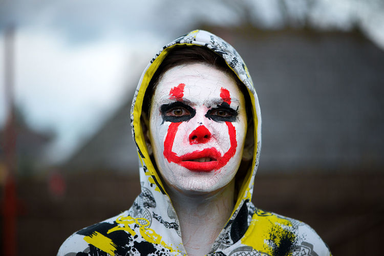 Halloween Portrait Halloween Halloween EyeEm One Person Only Red Adult Close-up Clown Day Face Paint Focus On Foreground Front View Halloween Halloween Concept Headshot One Man Only One Person Only One Person Outdoors People Real People Teenage Boys Teenager White Yellow Young Adult Fashion Stories