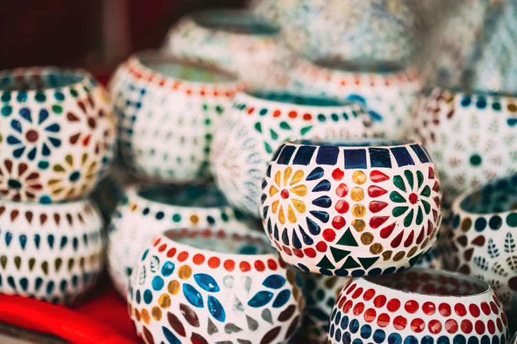 Close-up of multi colored ceramics for sale at market
