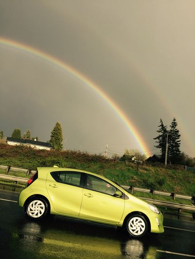Rainbow Double Rainbow Car Transportation Mode Of Transport No People Beauty In Nature Day Scenics Outdoors Multi Colored Tree Sky
