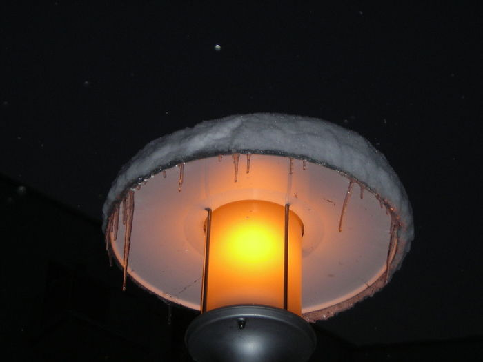 Low angle view of lit light bulb