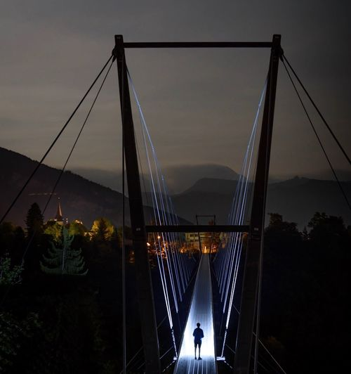Connection Bridge - Man Made Structure Engineering Architecture Built Structure Suspension Bridge Night Bridge Real People Illuminated Transportation Outdoors Sky Silhouette Men Women One Person Tree City Chain Bridge