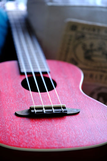 An ukulele is lying on a couch. Close-up Day Fretboard Guitar Indoors  Music Musical Equipment Musical Instrument Musical Instrument String No People Ukulele Woodwind Instrument