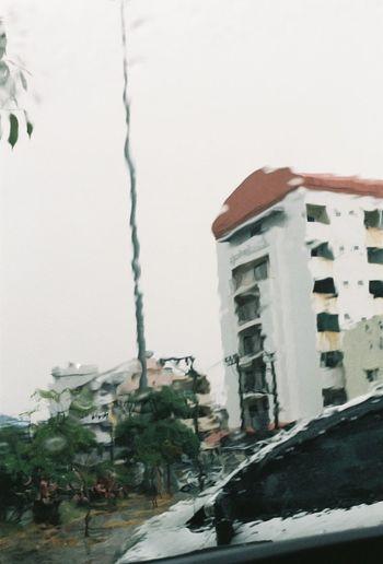 Buildings against clear sky during rainy season