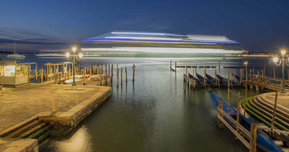 Architecture Blurred Motion Building Exterior Built Structure Illuminated Light Lighting Equipment Long Exposure Mode Of Transportation Moored Nature Nautical Vessel Night No People Outdoors Pier Reflection Sky Transportation Water