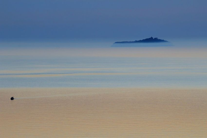 Sea Water Tranquility Beauty In Nature Horizon Over Water Outdoors Landscape Horizon View Panoramic Landscape Smallisland Sunlight Foggy Weather Fotografia Photography Photopassion Ships⚓️⛵️🚢 Ship Fog Foggy Landscape Foggy Sea Foggy Seascape Islandlife Island Islandphotography
