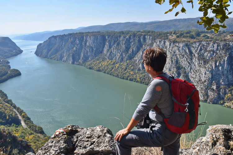 Danube gorge, Serbia Woman Activity Backpack Beauty In Nature Landscape Leisure Activity Lifestyles Looking At View Mature Adult Mountain Mountain Range Nature Non-urban Scene One Person Outdoors Real People Rear View River Rock Rock - Object Scenics - Nature Solid Trip Vacations Water A New Beginning