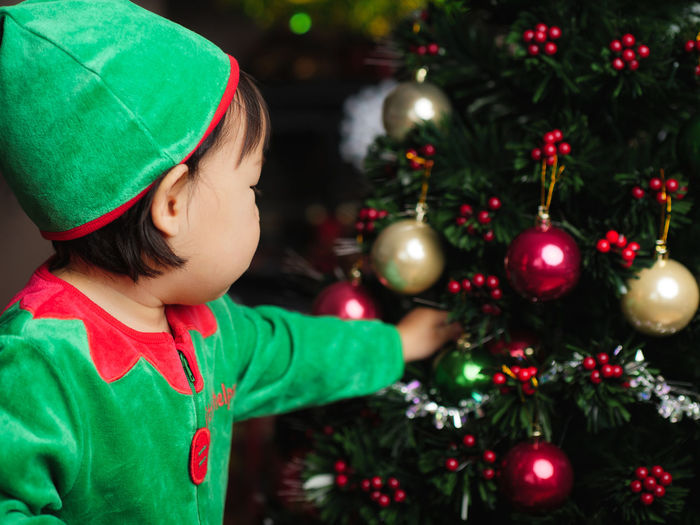 Asian Baby Girl Celebration Childhood Christmas Christmas Decoration Christmas Ornament Christmas Tree Close-up Day Focus On Foreground Green Color Indoors  One Person People Real People Tree