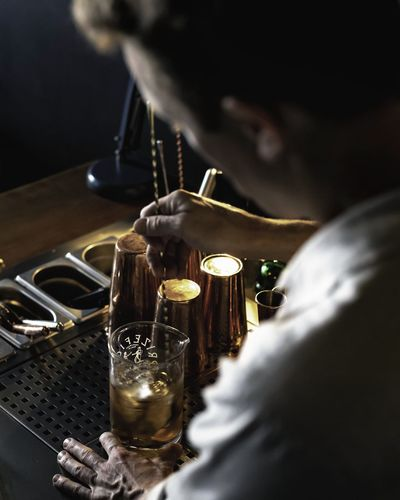 Close-up of man pouring wine in glass