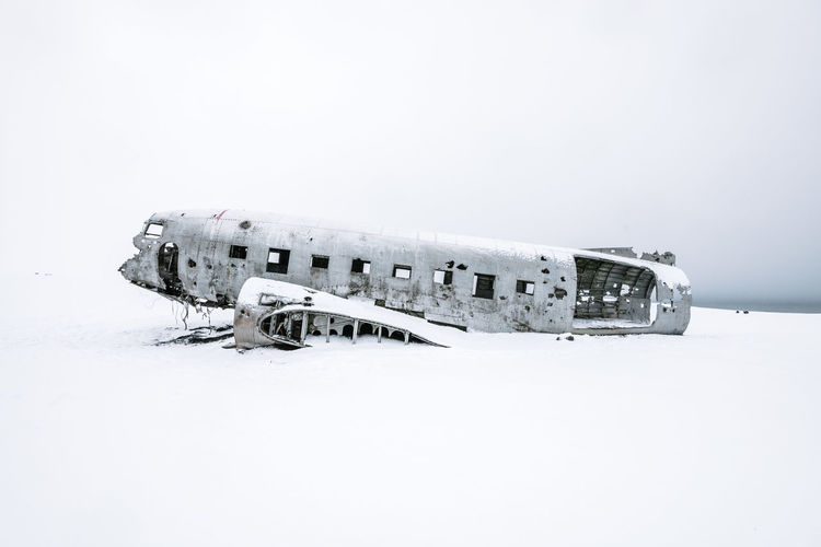 Abandoned Airplane Against Clear Sky During Winter