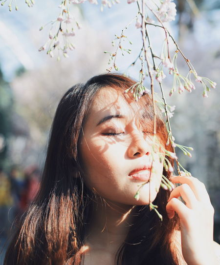 My Best Photo International Women's Day 2019 Streetwise Photography One Person Real People Headshot Portrait Lifestyles Focus On Foreground Young Women Leisure Activity Plant Young Adult Hair Long Hair Hairstyle Nature Close-up Flower Day Flowering Plant Tree Outdoors Beautiful Woman Contemplation Teenager