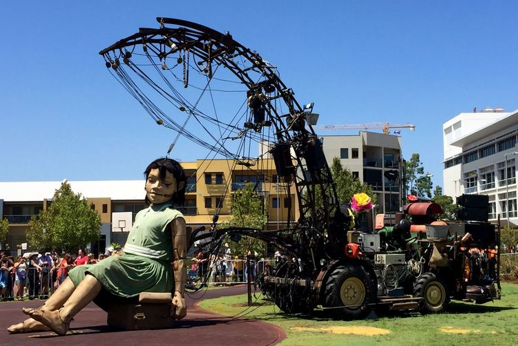 PERTH, AUSTRALIA-FEBRUARY 14, 2015: Journey of the Giants, Giant Marionette Diver and Little Girl, public International Arts Festival Art Art Event Arts Festivals Australia Belts And Pulleys City Cityscape Crane Crowds Culture Festival Giant Human International Journey Little Girl Marionette Marionette Sitting People Perth Puppeteers Walking Wooden