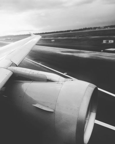 Airplane starting Aircraft Aircraft Wing Airplane Airport Airport Runway Blackandwhite Cloud Cloud - Sky Cropped Monochrome No People On The Move Public Transportation Runway Starting Airplane Transportation Turbine Wing
