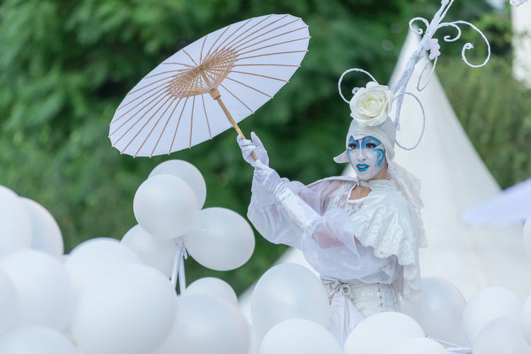 White sculpture with toy against blurred background