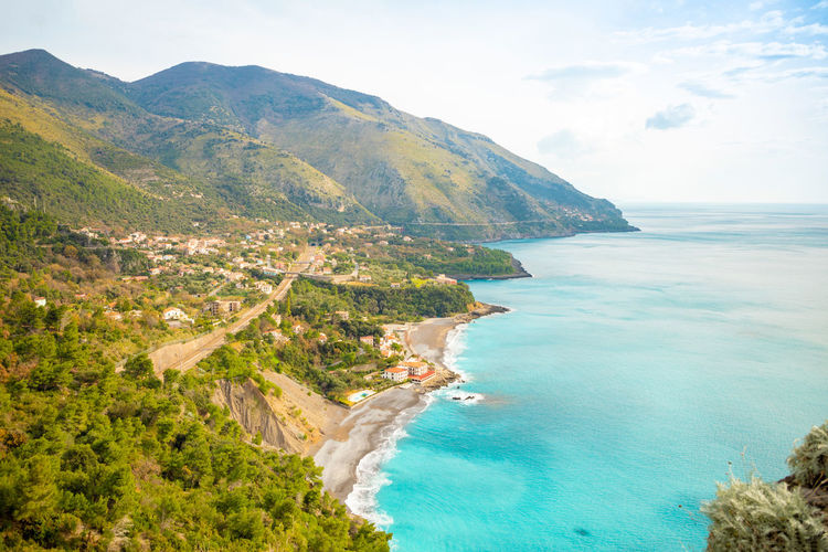 Italy Sicily Water Sea Scenics - Nature Beauty In Nature Tranquil Scene Sky Land Beach Tranquility Nature Mountain Horizon No People Idyllic Day Cloud - Sky Horizon Over Water Non-urban Scene Plant Outdoors Turquoise Colored