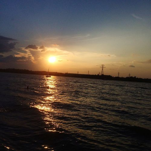 Mood Sunrise_sunsets_aroundworld BeautyfulSky BeautifulRiver River Day Out Sky Sunset_collection Water Sailing Ship Wind Power Sea Sunset Power In Nature Beauty Seascape Romantic Sky Atmospheric Mood Moody Sky Sky Only Dramatic Sky