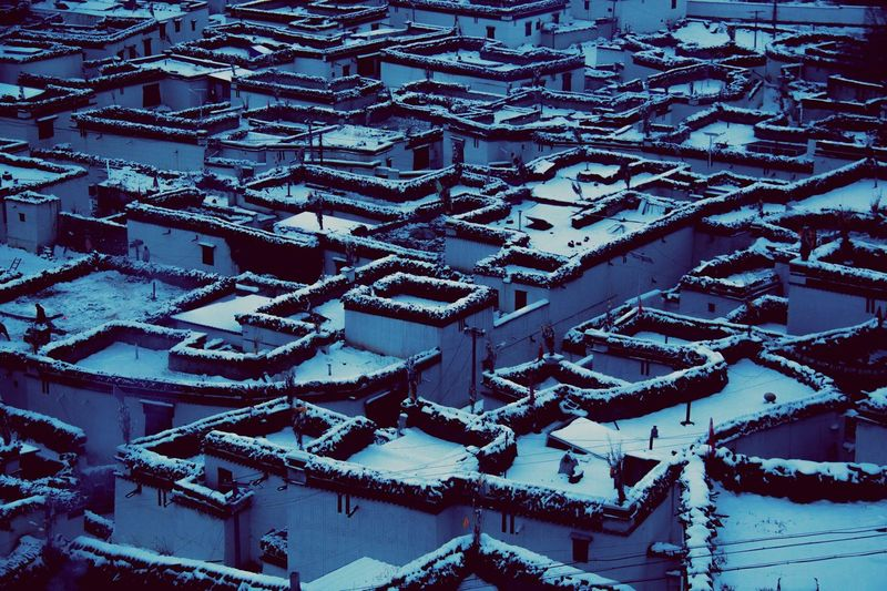 High angle view of snow covered roof and buildings