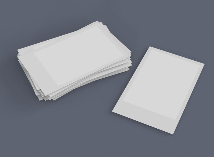 High angle view of open book against white background