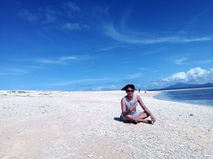 Warm and breezy Summer Island Escapade Sand Sandbar Sand & Sea Sky WhiteSandBeach Blue Sky EyeEm Selects Sea Full Length Sitting Water Beach Young Women Sand Blue Summer Relaxation