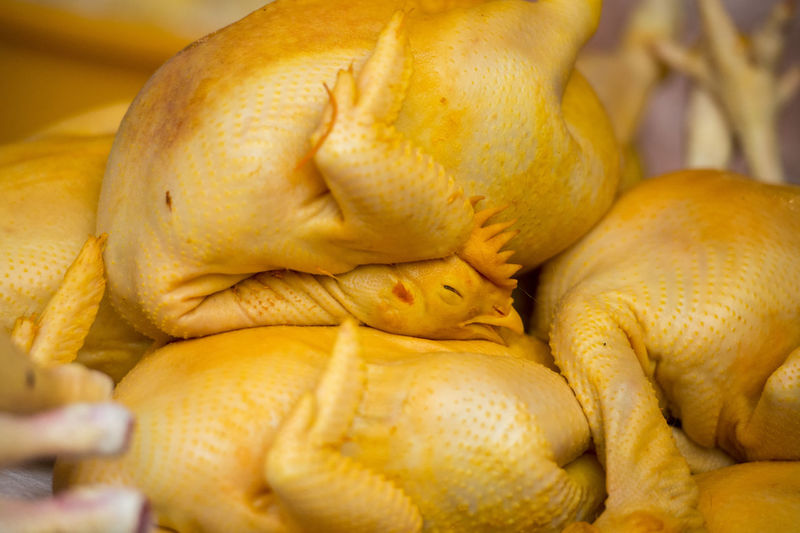 Close-up of raw chickens for sale at market stall