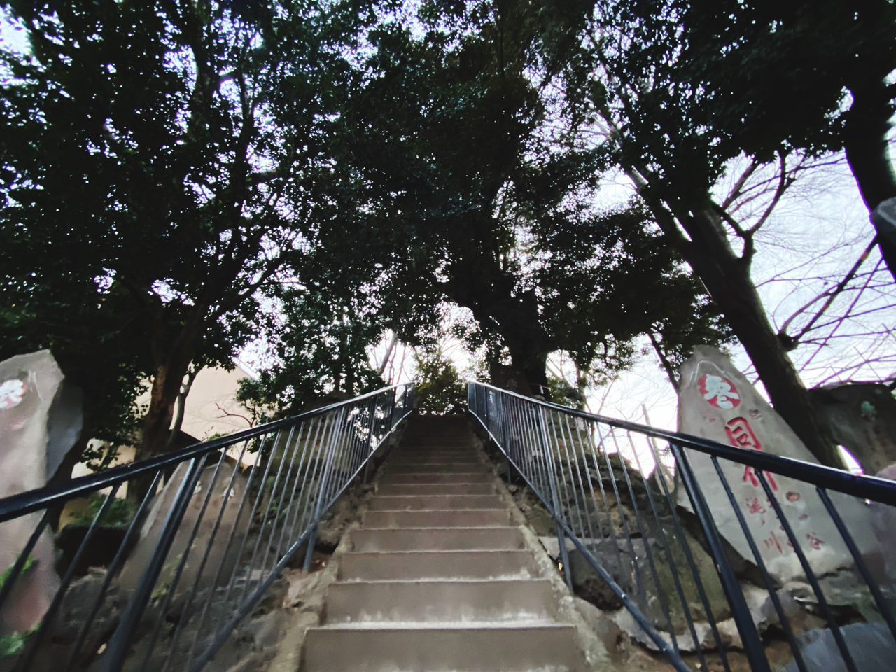 LOW ANGLE VIEW OF STEPS AND FOOTBRIDGE