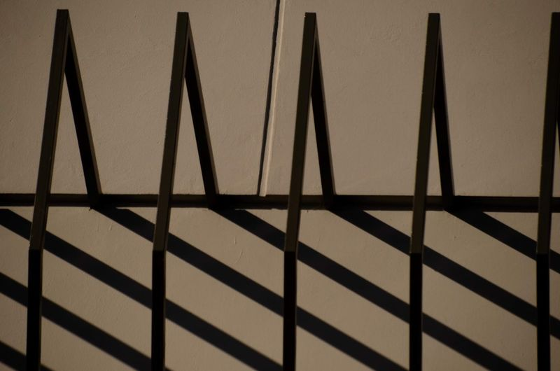 Silhouette Fence Against Wall
