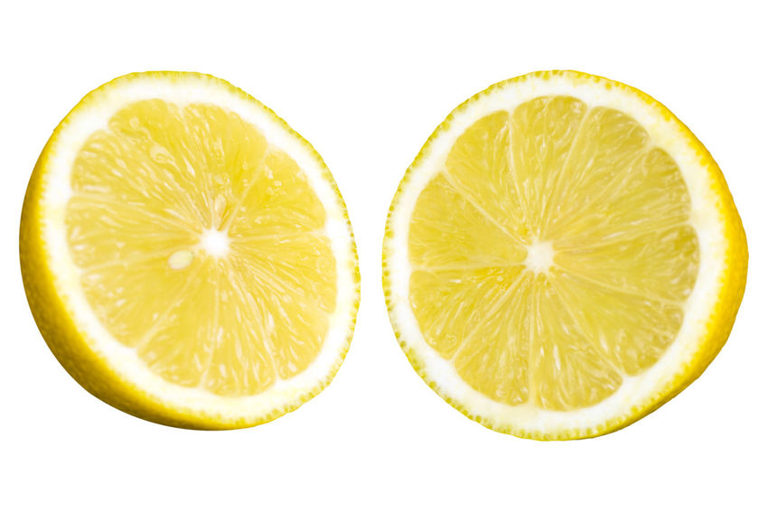 Close-up of a Yellow halved Lemon Fruit isolated on white Background. Lemon Lemons Yellow Fruit Yellow Cut Out Two Objects Fruit Food Isolated White Background SLICE Food And Drink Citrus Fruit Healthy Eating Wellbeing Cross Section Freshness Studio Shot Still Life Indoors  No People Close-up Shape Halved Circle Geometric Shape Orange Antioxidant Vitamin C