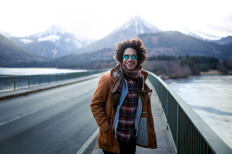 Young men is having great time on a bridge with mountains in background Abroad Christmas Cool Outdoor Pictures Travel Travel Photography Traveling Vacations Winter Wintertime Good Vibes Hipster Outdoor Photography Outdoors Snow Sunglasses Travel Destinations Vacation Winter Wonderland Winter_collection Fresh On Market 2017