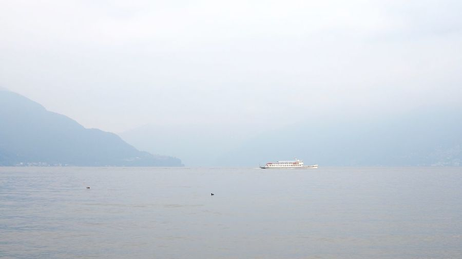 Beauty In Nature Day Fog Lagomaggiore Lake Lake View Mode Of Transport Mysterious Nature Nautical Vessel No People Outdoors Sailing Scenics Ship Sky Switzerland Ticino Tranquility Transportation Water