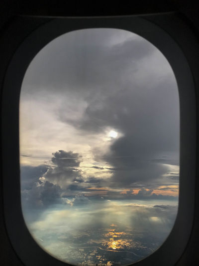Airplane sunset view ✈️ Cloud - Sky Sky Airplane Window Glass - Material Vehicle Interior Mode Of Transportation Air Vehicle Transparent Nature No People Beauty In Nature Sunset Travel Transportation Flying Journey Clouds And Sky