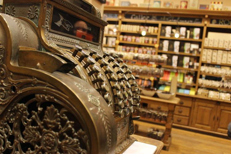 Close-up of cash register machine in store