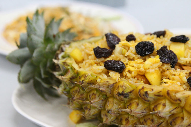 Thai pineapple fried rice with the pineapple, cashew nut, egg and raisin on top Bangkok Thailand Pineapple Raisin Close-up Cooked Crockery Dinner Focus On Foreground Food Food And Drink Freshness Fruit Healthy Eating Indoors  Indulgence Meal Pineapple Rice Plate Ready-to-eat Selective Focus Serving Dish Serving Size Still Life Thai Food Wellbeing