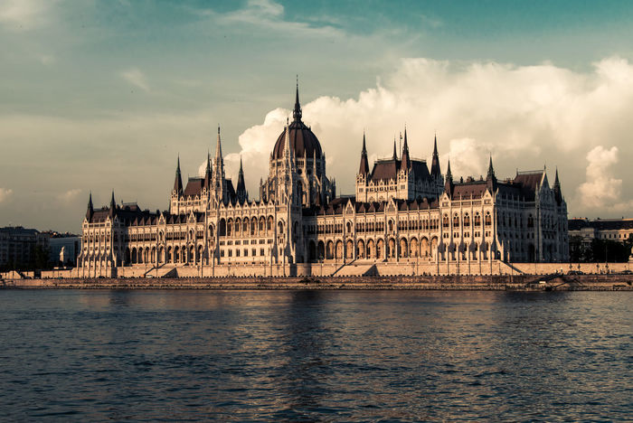 Budapest Architecture Building Building Exterior Built Structure City Cloud - Sky Gothic Style Government Nature No People Outdoors Parliament Of Budapest River Sky Spire  Tourism Travel Travel Destinations Water Waterfront