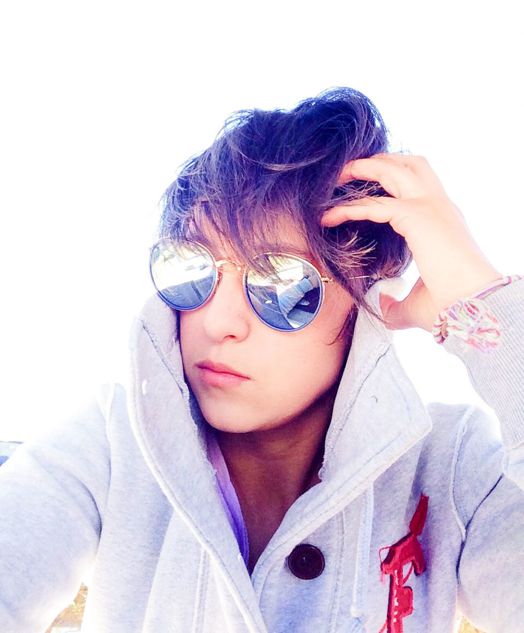 Close-Up Of Woman Wearing Sunglasses Against Clear Sky