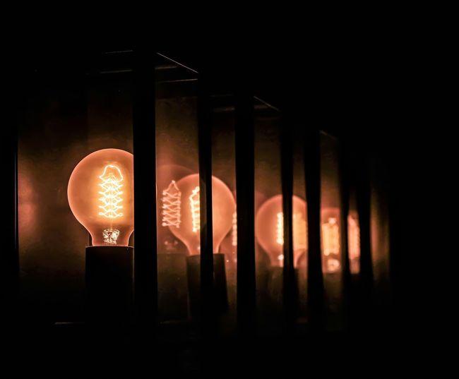 Illuminated No People Dark Indoors  Lighting Equipment Architecture Glowing Orange Color Built Structure Glass - Material Nature Transparent Light - Natural Phenomenon Close-up Night Silhouette Window Building Studio Shot Architectural Column Black Background