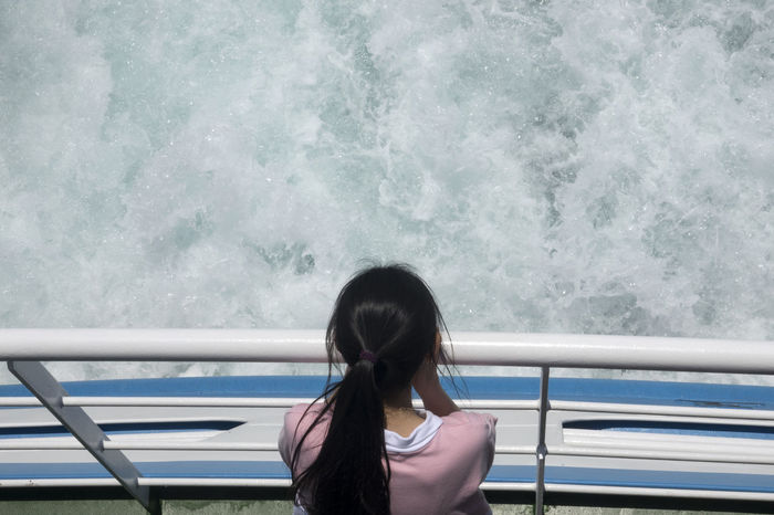 On board to Udo Island in Jeju Island, South Korea JEJU ISLAND  Passenger Childhood Day Girl Motion On Board On Boat One Person Outdoors People Railing Real People Sea Traveller Udo Voyage Water