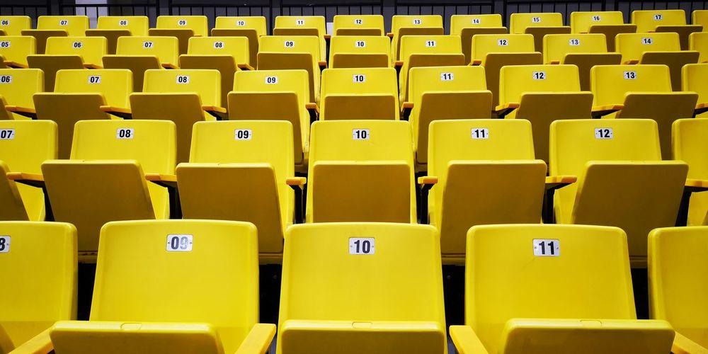 Full frame shot of yellow empty bleachers at stadium