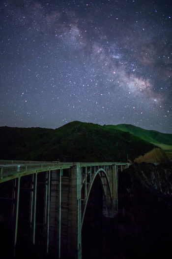 Arch Bridge Astronomy Bixby Bridge Bridge Bridge - Man Made Structure Built Structure Galaxy Nature Night No People Outdoors Scenics - Nature Sky Space Star Star - Space Star Field Transportation Water