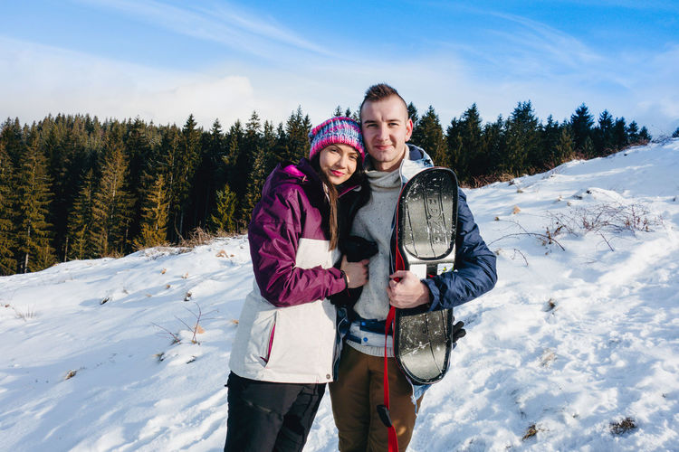 Happy couple Couple Family Winter Snow Cold Temperature Warm Clothing Togetherness Slope Mountain Mountains Scenery Nature Outdoors Holiday Vacations Winter Wintertime Winter Wonderland Pine Trees Hill Snowcapped Mountain Snowboarding Slide Happy Sonyrx100